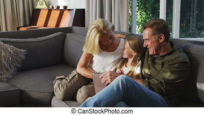 Grandparents and grandchild spending time together - ...
