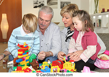 Grandparents and grandchildren playing