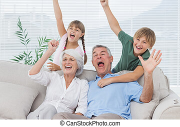 Grandparents and grandchildren raising arms
