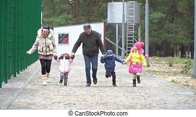 Grandparents and grandchildren running