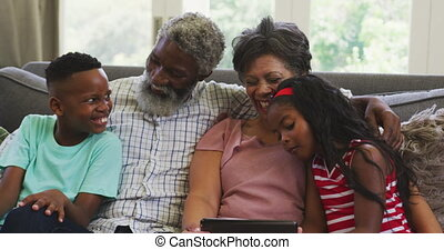 Grandparents and grandchildren spending time together - ...
