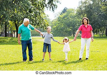 Grandparents And Grandchildren Together In Park