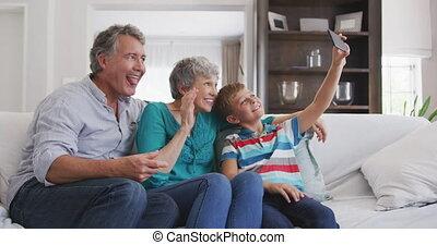 Grandparents and grandson spending time together - Front ...