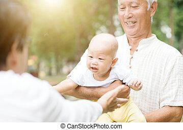 Grandparents and grandson.