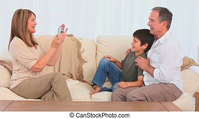 Grandparents and their grandson with a camera