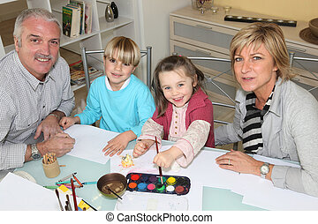 Grandparents drawing with their grandchildren