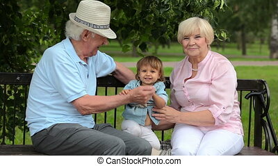 Grandparents - Senior members of the family playing with...