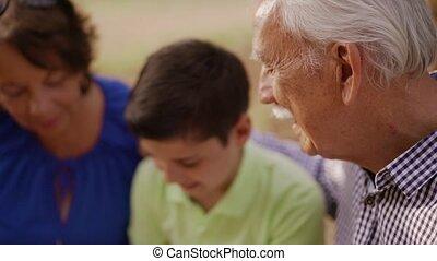 Grandparents Helping Child Doing School Homework