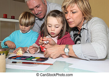 grandparents painting with their grandchildren