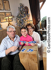 Grandparents playing game with little girl