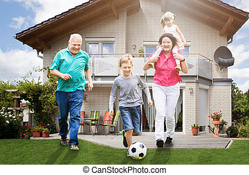 Grandparents Playing Soccer With Their Grandchildren