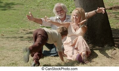 Grandparents playing with child - Happy grandfather and...