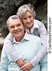 Grandparents - Portrait of a happy senior couple embracing