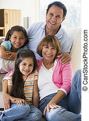 Grandparents posing with grandchildren.