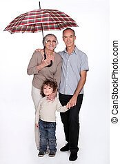 Grandparents posing with their grandchild