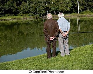 Grandparents, seniors. - Grandparents talking a walk, ...