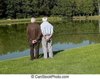 Grandparents, seniors. - Grandparents talking a walk,...