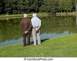 Grandparents, seniors. - Grandparents talking a walk,...