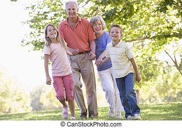 Grandparents walking with grandchildren.