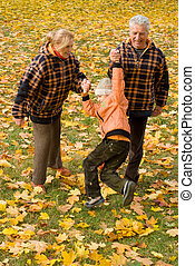 grandparents with child at nature