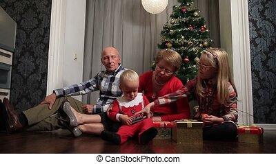Grandparents with children celebrating Christmas