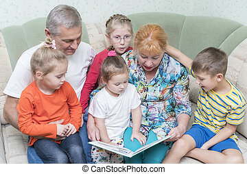 Grandparents with grandchildren on the couch
