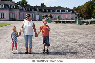 Grandparents With Grandchildren walking together in the park