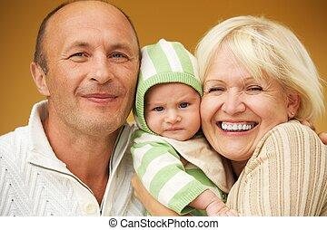 Grandparents with his grandchild