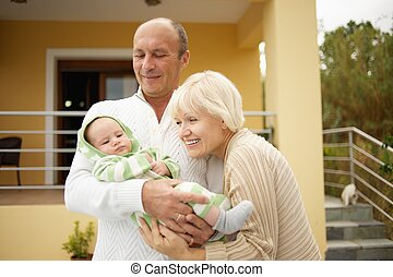 Grandparents with little child