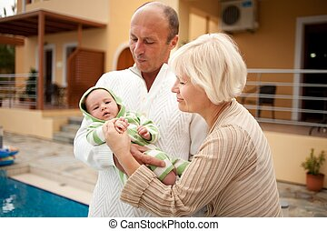Grandparents with their grandchild.