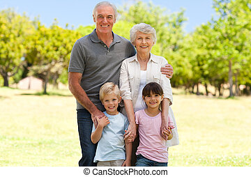 Grandparents with their grandchildren in the park