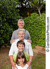 Grandparents with their grandchildren looking at the camera