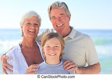 Grandparents with their grandson at the beach