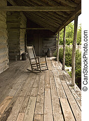 Rocking chair on a wooden floor back porch.