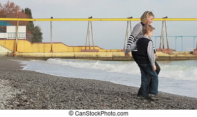 grandson and grandmother on the sea