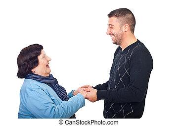Grandson having conversation with grandma
