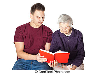 Grandson reading a novel with grandma