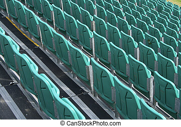 Grandstand - Rows of plastic seating at sports venue