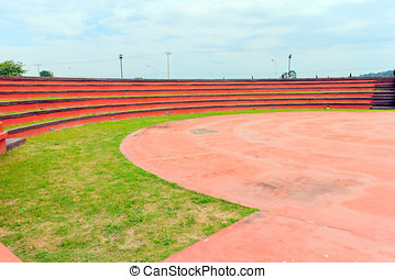 Grandstand - Red grandstand in arena with blue sky