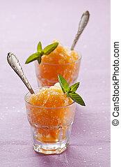 Fresh orange granita with mint close up shoot