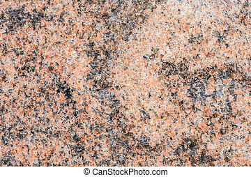 Granite, basalt or marble stone crystal texture of polished gravestone. The macro shot is made by means of stacking technology