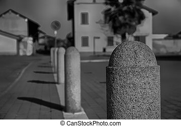 Granite cement stone, enclosed in a row for the parking space