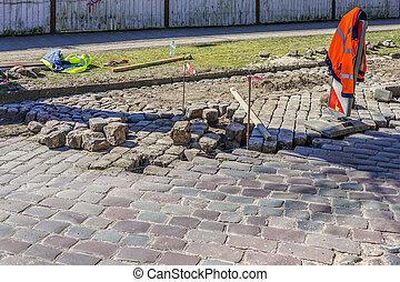 granite cobblestone pavement repair in city street