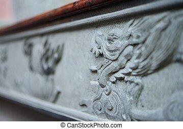 Granite craving dragon face