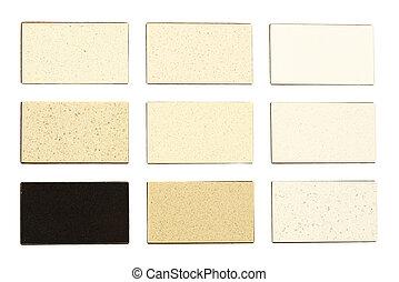 Granite samples for kitchen countertops over white