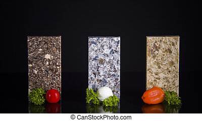 Granite samples of kitchen countertops - Three granite...