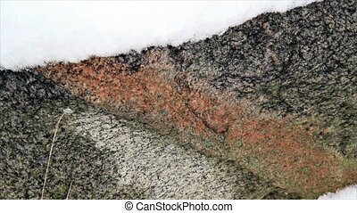Granite Snow Widescreen - A colorful granite boulder with...