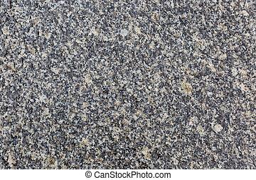 Granite stone texture - Close up photo of granite stone wall