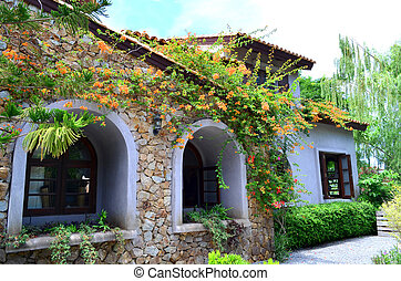 Granite stone wall building with arch