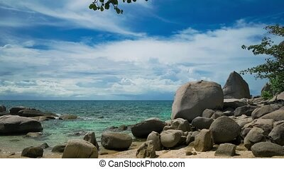 Granite stones on the beach of an tropical island. Clouds...